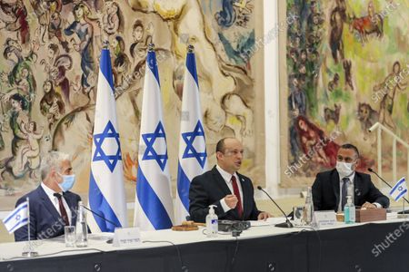 Stock Image of Israeli Prime Minister Naftali Bennett, center, chairs the weekly cabinet meeting as Alternate Prime Minister and Foreign Minister Yair Lapid, left, looks, at the Knesset in Jerusalem