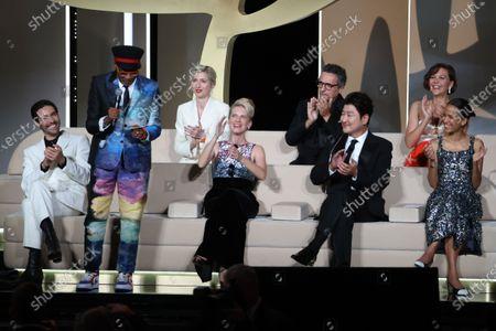 Jury President Spike Lee, Jury members Tahar Rahim, Jessica Hausner, Melanie Laurent, Kleber Mendonca Filho, Kang-Ho Song, Maggie Gyllenhaal, Mati Diop on stage, Closing Ceremony, during the 74th International Cannes Film Festival, at Palais des Festivals, Cannes