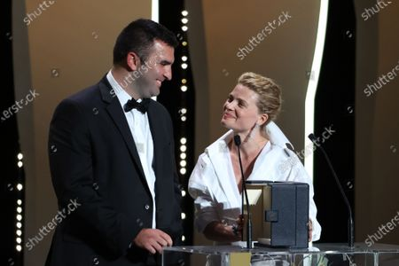 Frank Graziano and Camera dõor jury president Melanie Thierry pose with the 'Camera d'Or Award' for 'Murina' in the name of Antoneta Alamat Kusijanovic, Closing Ceremony, during the 74th International Cannes Film Festival, at Palais des Festivals, Cannes