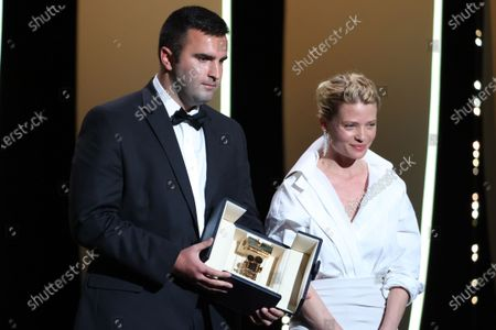 Frank Graziano and Camera dÃor jury president Melanie Thierry pose with the 'Camera d'Or Award' for 'Murina' in the name of Antoneta Alamat Kusijanovic, Closing Ceremony, during the 74th International Cannes Film Festival, at Palais des Festivals, Cannes