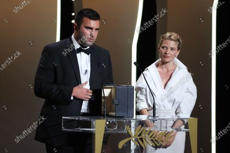Frank Graziano and Camera dÃoror jury president Melanie Thierry pose with the 'Camera d'Or Award' for 'Murina' in the name of Antoneta Alamat Kusijanovic, Closing Ceremony, during the 74th International Cannes Film Festival, at Palais des Festivals, Cannes