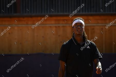 Mikael Ymer of Sweden reacts while playing against Enzo Couacaud of France during their round of 16 match at the Swiss Open tennis tournament in Gstaad, Switzerland, 19 July 2021.