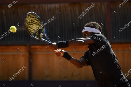 Mikael Ymer of Sweden in action against Enzo Couacaud of France during their round of 16 match at the Swiss Open tennis tournament in Gstaad, Switzerland, 19 July 2021.