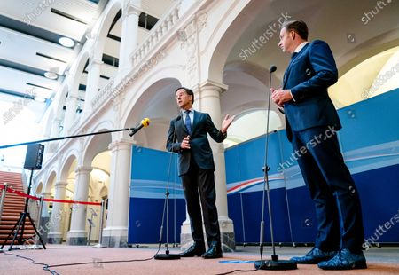 Outgoing Prime Minister Mark Rutte (L) and outgoing Minister of Health, Welfare and Sport (CDA), Hugo de Jonge (R), in conversation with the press about the latest state of affairs regarding the coronavirus in The Hague, The Netherlands, 19 July 2021. The cabinet will provide an update on the COVID-19 crisis every Monday during the summer recess.