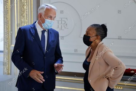 President of the foundation for the memory of slavery and former French Prime Minister Jean-Marc Ayrault (L) speaks with Former French Justice minister Christiane Taubira (R) prior to a ceremony to award Veteran American civil rights activist Reverend Jesse Jackson (not pictured) with the Legion of Honour at the Elysee Palace in Paris, France, 19 July 2021.