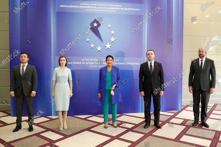 In this photo released by Georgian Presidential Press Office, from the left: Volodymyr Zelenskyy, Moldova's President Maia Sandu, Georgian President Salome Zurabishvili, Georgian Prime Minister Irakli Garibashvili and EU Council President Charles Michel pose for a photo on the sidelines of a Batumi International Conference - Enduring Power of Attraction in Batumi, Georgia