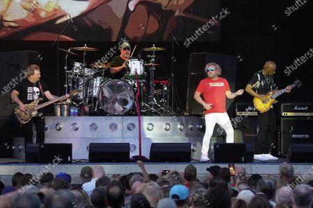 Michael Anthony, (from Left) Jason Bonham, Sammy Hagar, and Vic Johnson perform at RiverEdge Park in Aurora, Ill. on