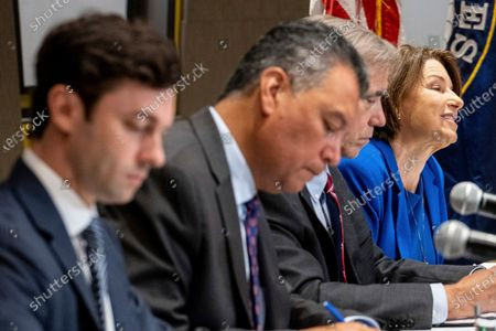 Sens. Jon Ossoff, D-Ga., from left, Alex Padilla, D-Calif., Jeff Merkley, D-Ore., and Amy Klobuchar, D-Minn., conduct a Senate Rules Committee field hearing on voting rights at the National Center for Civil and Human Rights in Atlanta