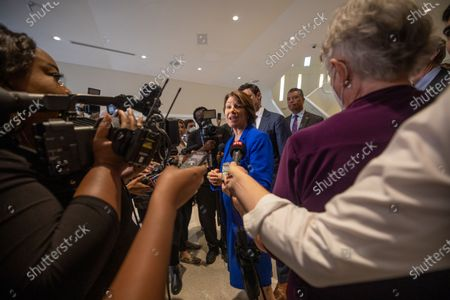 Senator Amy Klobuchar (D-MN) and Senator Jon Ossoff (D-GA), amongst other Senators, talk to media seen after a field hearing at the National Center for Civil and Human Rights of the Senate Rules Committee in Atlanta, Georgia on July 19th, 2021.
