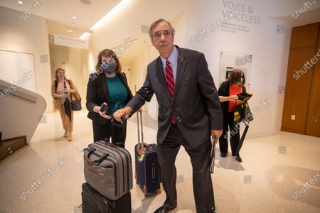 Senator Jeff Merkley (D-OR) is seen with luggage after a field hearing at the National Center for Civil and Human Rights of the Senate Rules Committee in Atlanta, Georgia on July 19th, 2021.
