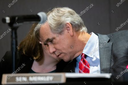Senator Jeff Merkley (D-OR) talks to a staffer while listening to testimony at a field hearing at the National Center for Civil and Human Rights of the Senate Rules Committee in Atlanta, Georgia on July 19th, 2021.