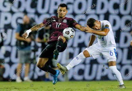 Mexico forward Jesus Corona (17) battles El Salvador midfielder Narciso Orellana (6) for the ball during a CONCACAF Group A soccer match, in Dallas. Mexico won 1-0