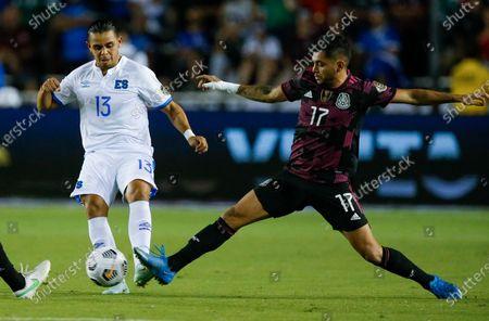 El Salvador defender Alexander Larin (13) battles Mexico forward Jesus Corona (17) for the ball during a CONCACAF Group A soccer match, in Dallas. Mexico won 1-0