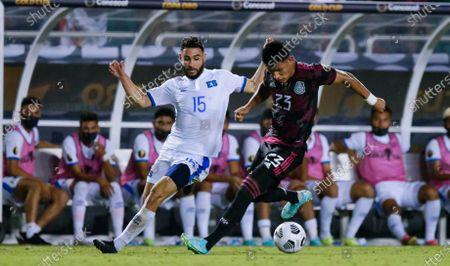 Stock Image of Mexico defender Jesus Gallardo (23) battles El Salvador midfielder Alexander Roldan (15) for the ball during a CONCACAF Group A soccer match, in Dallas. Mexico won 1-0