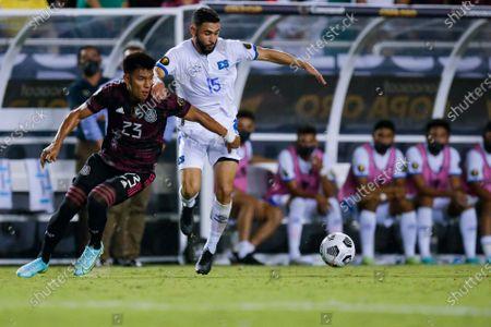 Mexico defender Jesus Gallardo (23) battles El Salvador midfielder Alexander Roldan (15) for the ball during a CONCACAF Group A soccer match, in Dallas. Mexico won 1-0