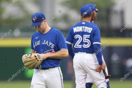 Toronto Blue Jays starting pitcher Ross Stripling, left, walks to the dugout after being pulled during the first inning of a baseball game against the Boston Red Sox, in Buffalo, N.Y