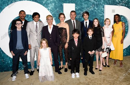 """Actors Luca Faustino Rodriguez, left, Aaron Pierre, director M. Night Shyamalan, Kylie Begley, Gael Garcia Bernal, Vicky Krieps, Rufus Sewell, Kailen Jude, Alex Wolff, Nolan River, Alexa Swinton, Mikaya Kenzie Fisher, Nikki Amuka-Bird pose together at the world premiere of """"Old"""" at Rose Theater at Jazz at Lincoln Center, in New York"""