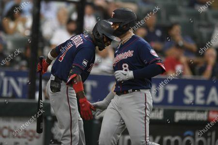Stock Photo of Minnesota Twins' Mitch Garver (8) celebrates with teammate Nick Gordon