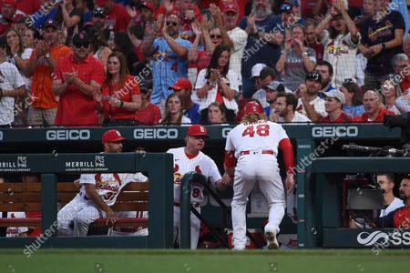 St. Louis Cardinals' Harrison Bader (48) is congratulated by head coach Mike Shiltd after scoring a run during the third inning of a baseball game against the Chicago Cubs, in St. Louis