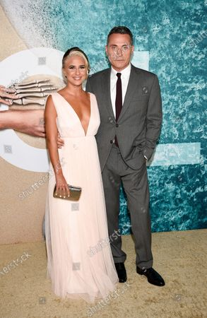 """Actor Rufus Sewell, right, and girlfriend Vivian Benitez attend the world premiere of """"Old"""" at Rose Theater at Jazz at Lincoln Center, in New York"""