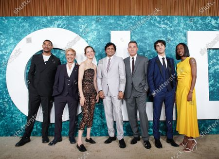 """Aaron Pierce, Gael Garc'a Bernal, Vicky Krieps, M. Night Shyamalan, Rufus Sewell, Alex Wolff and Nikki Amuka-Bird arrive on the red carpet at the """"Old"""" New York Premiere at Jazz at Lincoln Center on Monday, July 19, 2021 in New York City."""