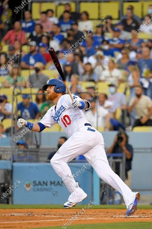 Los Angeles Dodgers' Justin Turner runs to first as he hits a solo home run during the first inning of a baseball game against the San Francisco Giants, in Los Angeles