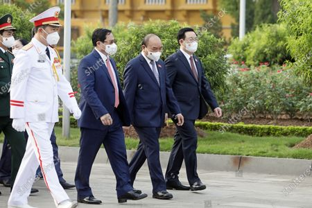 Vietnam's Prime Minister Pham Minh Chinh (3-R), President Nguyen Xuan Phuc (C) and Chairman of the National Assembly Vuong Dinh Hue  (R) attend a wreath laying ceremony ahead the first session of 15th National Assembly in Hanoi, Vietnam 20 July 2021. The first session of 15th National Assembly will takes place in Hanoi from 20 July to 05 August 2021.
