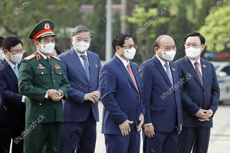 (L-R) Vietnam's Deputy Prime Minister Pham Binh Minh, Defence Minister Phan Van Giang, Public Security Minister To Lam, Prime Minister Pham Minh Chinh, President Nguyen Xuan Phuc and Chairman of the National Assembly Vuong Dinh Hue attend a wreath laying ceremony ahead the first session of 15th National Assembly in Hanoi, Vietnam 20 July 2021. The first session of 15th National Assembly will takes place in Hanoi from 20 July to 05 August 2021.