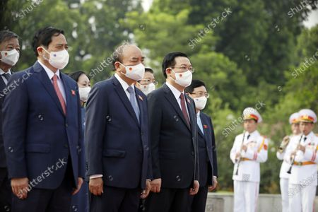 Stock Picture of (L-R) Prime Minister Pham Minh Chinh, President Nguyen Xuan Phuc, Chairman of the National Assembly Vuong Dinh Hue attend a wreath laying ceremony at Vietnam War Memorial ahead the first session of 15th National Assembly in Hanoi, Vietnam, 20 July 2021. The first session of 15th National Assembly will takes place in Hanoi from 20 July to 05 August 2021.