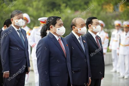 Stock Image of (L-R) Vietnam's Public Security Minister To Lam, Prime Minister Pham Minh Chinh, President Nguyen Xuan Phuc, Chairman of the National Assembly Vuong Dinh Hue attend a wreath laying ceremony at Vietnam War Memorial ahead the first session of 15th National Assembly in Hanoi, Vietnam, 20 July 2021. The first session of 15th National Assembly will takes place in Hanoi from 20 July to 05 August 2021.