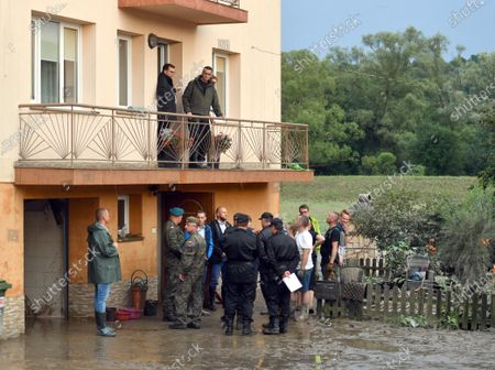 Prime Minister Mateusz Morawiecki and the Governor of Malopolska, Lukasz Kmita, investigate the damage after the flash flood from an apartment balcony in Glogoczow. Aftermath of flash flood in Glogoczow near Kraków.
