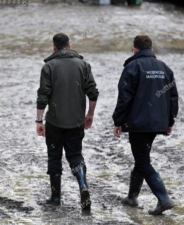 Stock Picture of Prime Minister Mateusz Morawiecki (L) and the Governor of Malopolska, Lukasz Kmita (R), take a walk to investigate the  damage caused by the flash flood in Glogoczów in Malopolska. Aftermath of flash flood in Glogoczow near Kraków.