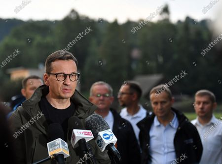 Stock Image of Prime Minister Mateusz Morawiecki speaks during a press conference at the site of a flash flood in Glogoczów. Aftermath of flash flood in Glogoczow near Kraków.