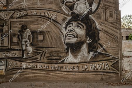 A mural celebrating the figure of late football legend Diego Maradona is seen in a rural city in the countryside. Maradona died at the age of 60 on November 25, 2020 of severe heart failure in circumstances that are still under investigation.