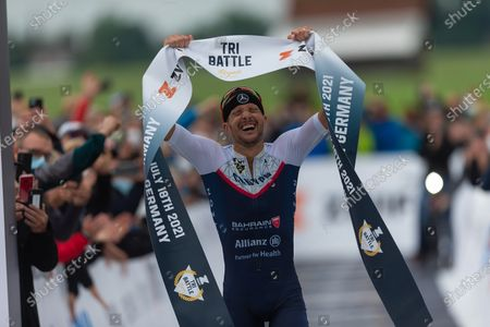 Stock Image of Jan Frodeno (GER) with world record (7:27:53 hours)