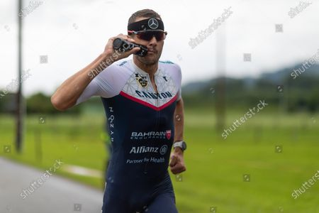 Stock Photo of Jan Frodeno (GER) with world record (7:27:53 hours)