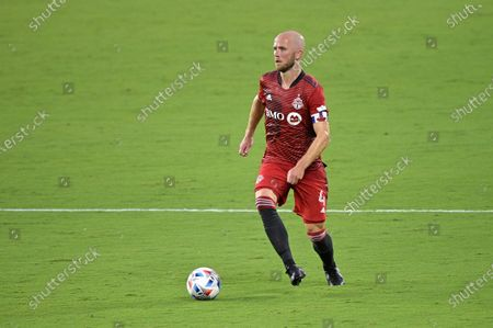 Toronto FC midfielder Michael Bradley (4) controls a ball during the first half of an MLS soccer match against Orlando City, in Orlando, Fla