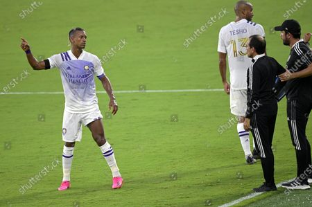 Orlando City forward Nani, left, talks with head coach Oscar Pareja, second from right, during the first half of an MLS soccer match against Toronto FC, in Orlando, Fla