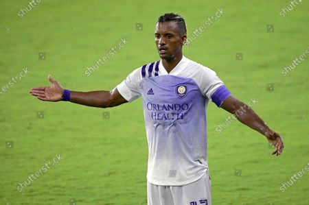 Orlando City forward Nani (17) argues a call by an official during the second half of an MLS soccer match against Toronto FC, in Orlando, Fla