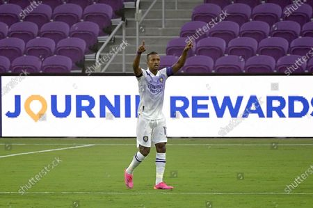 Orlando City forward Nani celebrates after scoring a goal during the first half of an MLS soccer match against Toronto FC, in Orlando, Fla