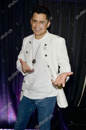 Colombian Singer Jorge Celedon poses for picture backstage