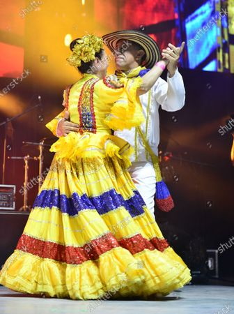 Colombian dancers onstage with singer Jorge Celedon performs