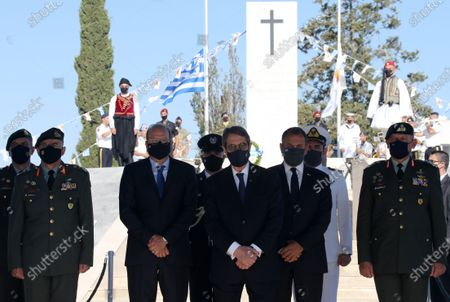 Cyprus President Nicos Anastasiades (C) attends a memorial service, for the soldiers who lost their lives fighting in the 1974 Turkish invasion of Cyprus, held annually at the Tymvos Makedonitissa military cemetery in Nicosia, Cyprus, 20 July 2021. The year 2021 marks the 47th anniversary of the Turkish invasion of Cyprus in 1974. Cyprus has been split since July 1974, when Turkish troops invaded the northern third of the island in response to a Greek-inspired coup aimed at uniting the island with Greece. The July invasion resulted in some three percent of the Island being captured by Turkish forces before a ceasefire was announced, while some 40 percent of the Island was occupied in the second Turkish invasion in August 1974.