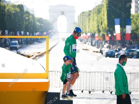 British Mark Cavendish of Deceuninck - Quick-Step after celebrating on the podium in the green jersey of leader in the sprint ranking at end of the 21th and last stage of the 108th edition of the Tour de France cycling race, 108 km between Chatou and Paris Champs-Elysees