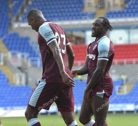 Issa Diop of West Ham United got the flick on with his head that ended up as a Reading own goal, celebrates with Michail Antonio