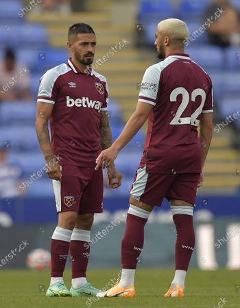 Said Benrahma of West Ham United shows off his new squad number as he chats to Manuel Lanzini (L)