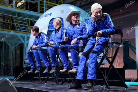 Oliver Daemen, from left, Mark Bezos, Jeff Bezos, founder of Amazon and space tourism company Blue Origin, and Wally Funk, right, watch a video replay of their flight experience aboard the Blue Origin New Shepard rocket from its spaceport near Van Horn, Texas