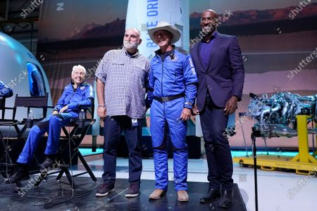 Wally Funk, left, looks on Jeff Bezos, second from right, founder of Amazon and space tourism company Blue Origin, poses for photos with Chef Jose Andres, second from left, and Van Jones, right, founder of Dream corps during a briefing following the launch of the New Shepard from its spaceport near Van Horn, Texas, . Andres and Jones were award Courage and Civility awards during the briefing