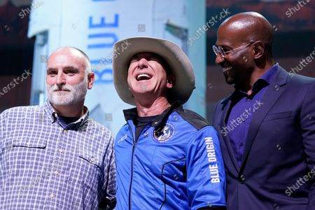 Jeff Bezos, center, founder of Amazon and space tourism company Blue Origin, poses for photos with Chef Jose Andres, left, and Van Jones, right, founder of Dream corps during a briefing following the launch of the New Shepard rocket from its spaceport near Van Horn, Texas, . Andres and Jones were awarded Courage and Civility awards during the briefing