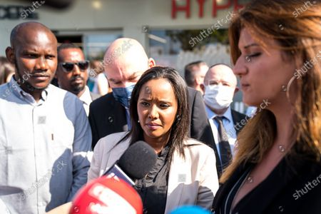L-R: Lassana Bathily, Pinina Tamano Shata and Marlene Schiappa    Marlene Schiappa and Pnina Tamano Shata, Israeli Minister of Immigration and Integration, ugly a wreath of flowers in front of the Hyper Kosher on Tuesday in tribute to the victims of the attack.